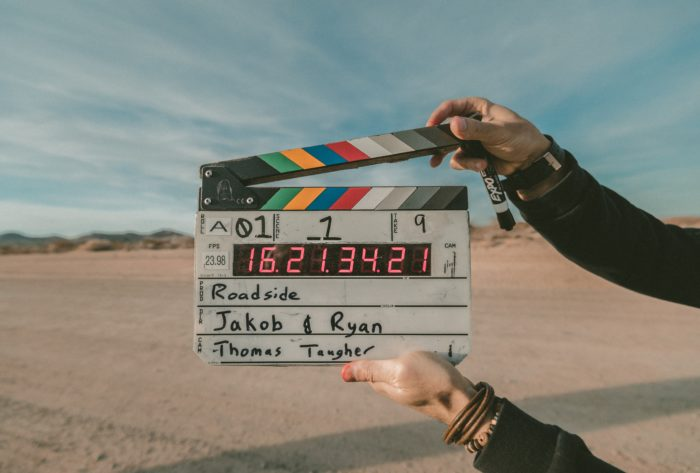 A photo of a film board ready to snap before the beginning of a scene.